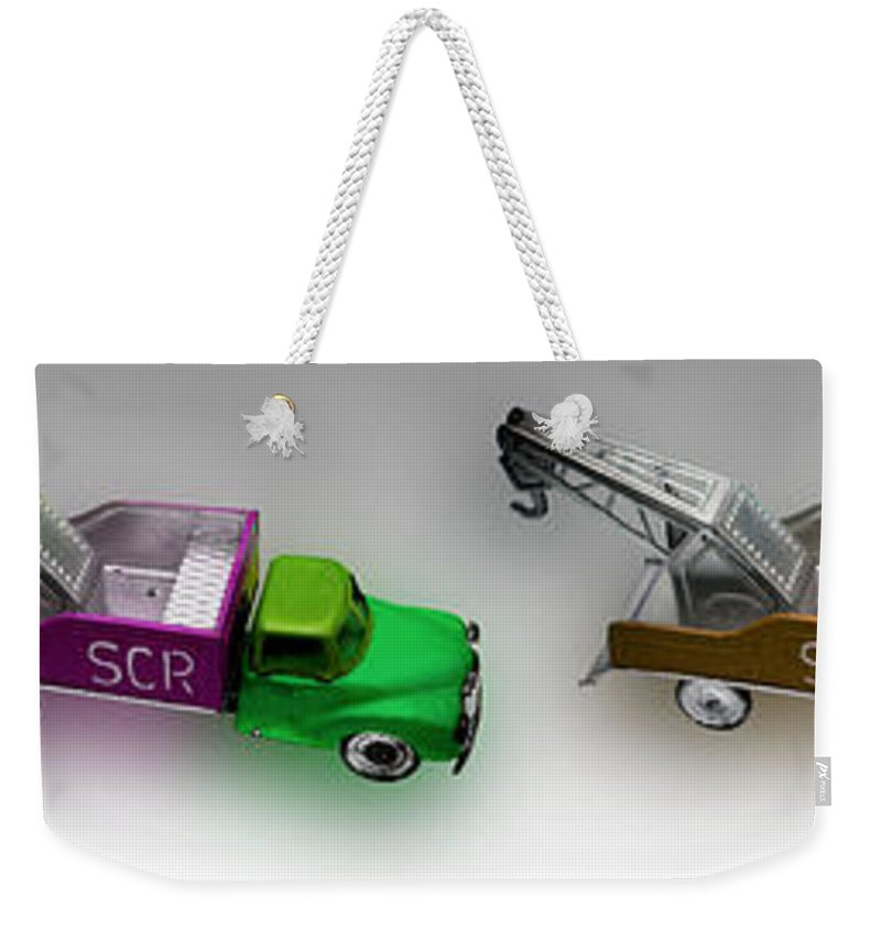Toy Weekender Tote Bag featuring the photograph Line Truckin by Charles Stuart
