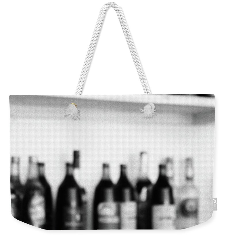 Bottles Weekender Tote Bag featuring the photograph Liquor Bottles by Gaspar Avila