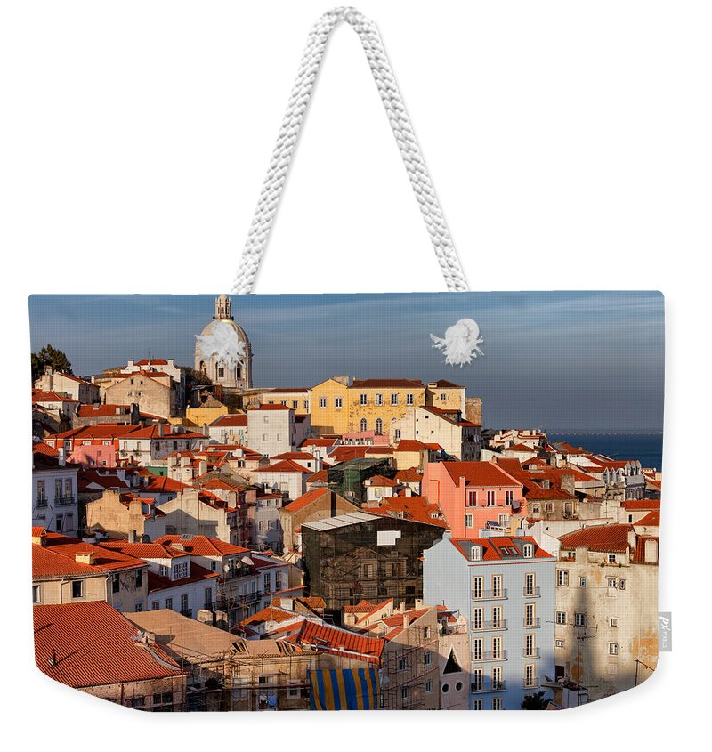 Lisbon Weekender Tote Bag featuring the photograph Lisbon Cityscape In Portugal At Sunset by Artur Bogacki