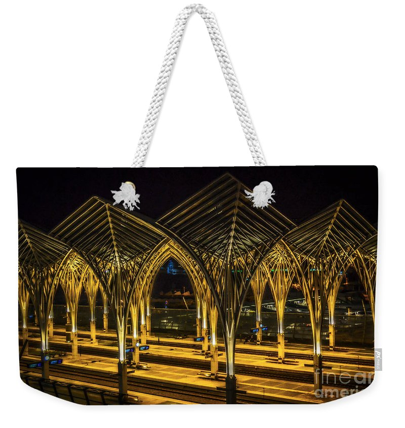 Lisbon Weekender Tote Bag featuring the photograph Lisbon Train Station At Night by Mary Machare