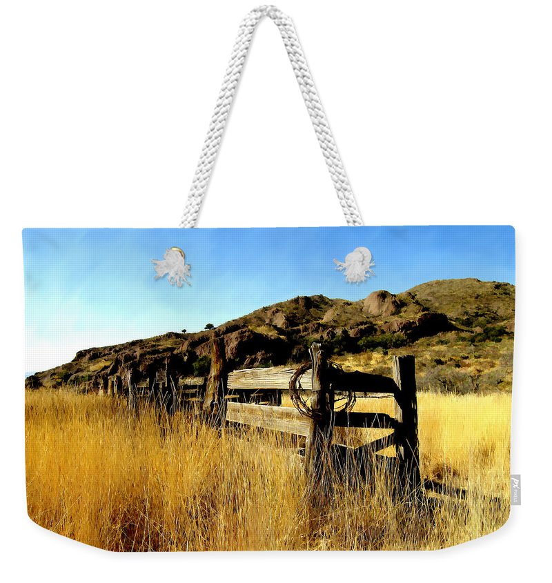 Southwestern Weekender Tote Bag featuring the photograph Livery Fence At Dripping Springs by Kurt Van Wagner