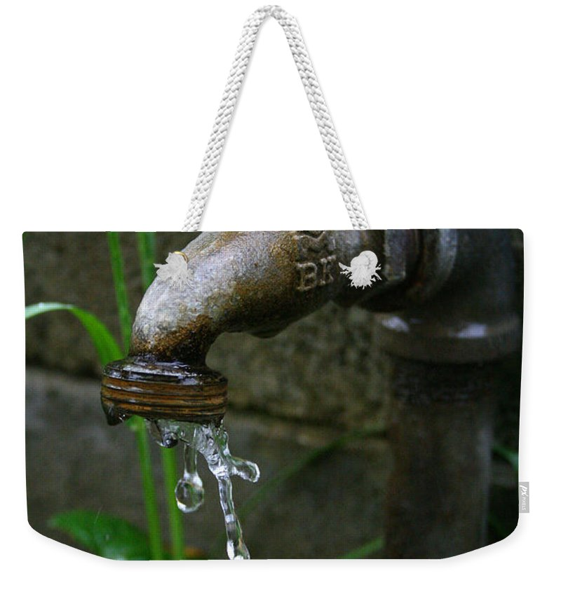 Water Faucet Valve Nature Garden Drop Dripping Red Wet Life Grow Nourish Rural Country Weekender Tote Bag featuring the photograph Living Water by Andrei Shliakhau