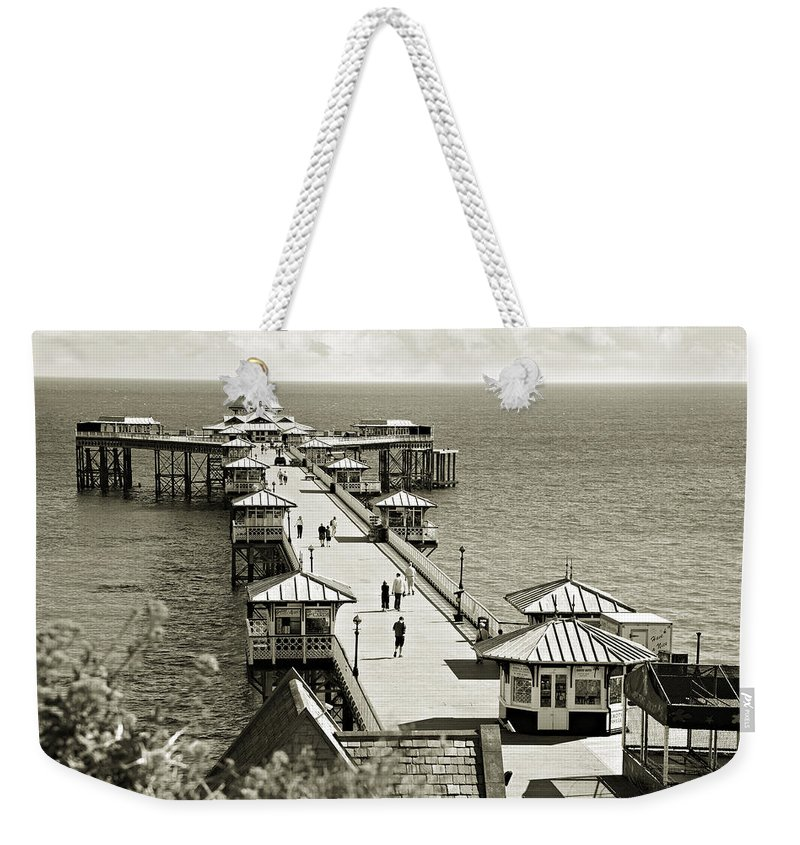 Pier Weekender Tote Bag featuring the photograph Llandudno Pier North Wales Uk by Mal Bray