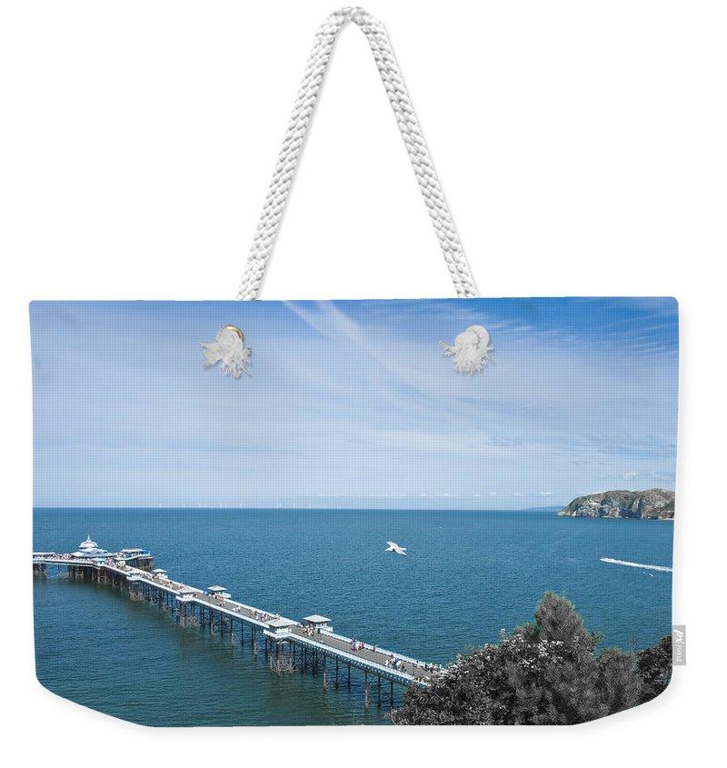 Aqua Weekender Tote Bag featuring the photograph Llandudno Pier by Svetlana Sewell