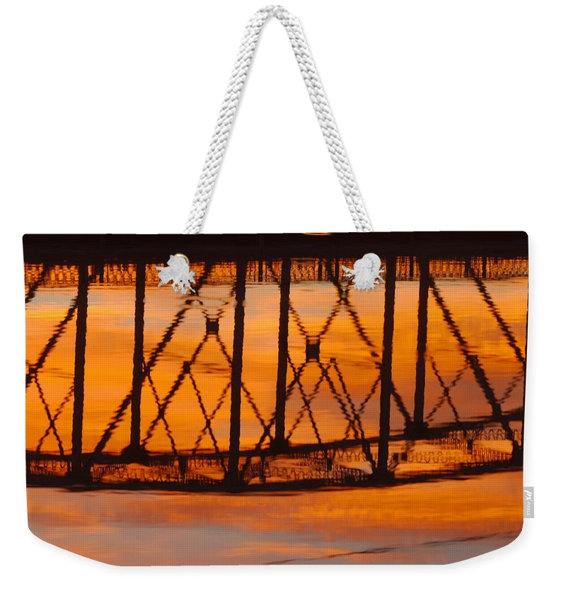 James Smullins Weekender Tote Bag featuring the photograph Llano Bridge Reflection by James Smullins