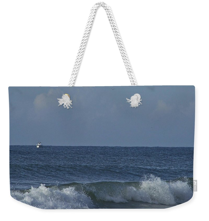 Boat Weekender Tote Bag featuring the photograph Lone Boat On The Horizon by Teresa Mucha