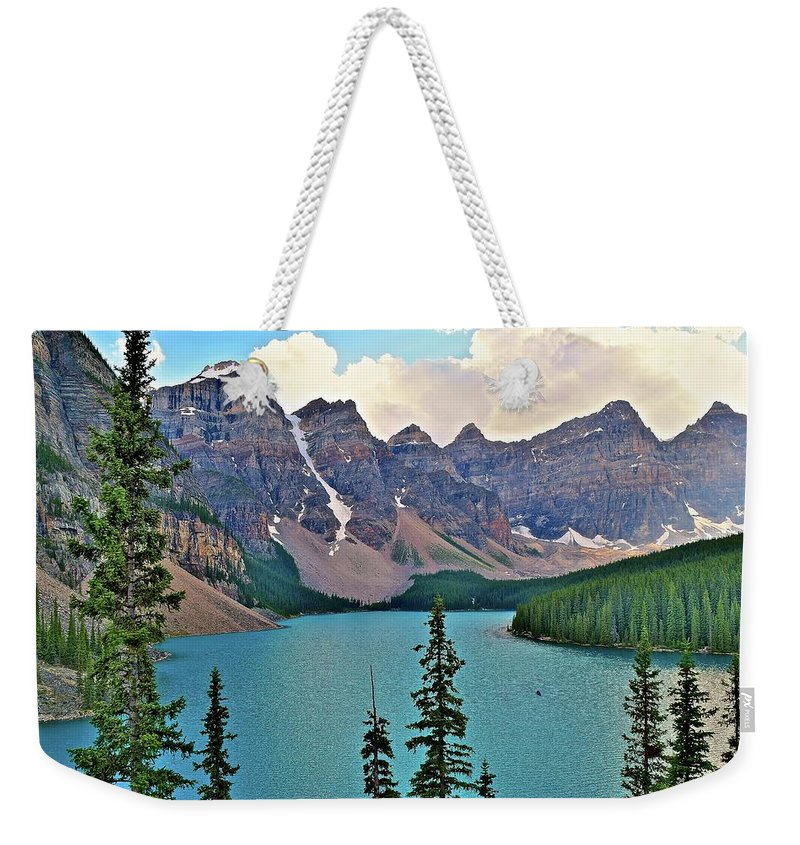 Moraine Weekender Tote Bag featuring the photograph Lone Canoe by Frozen in Time Fine Art Photography