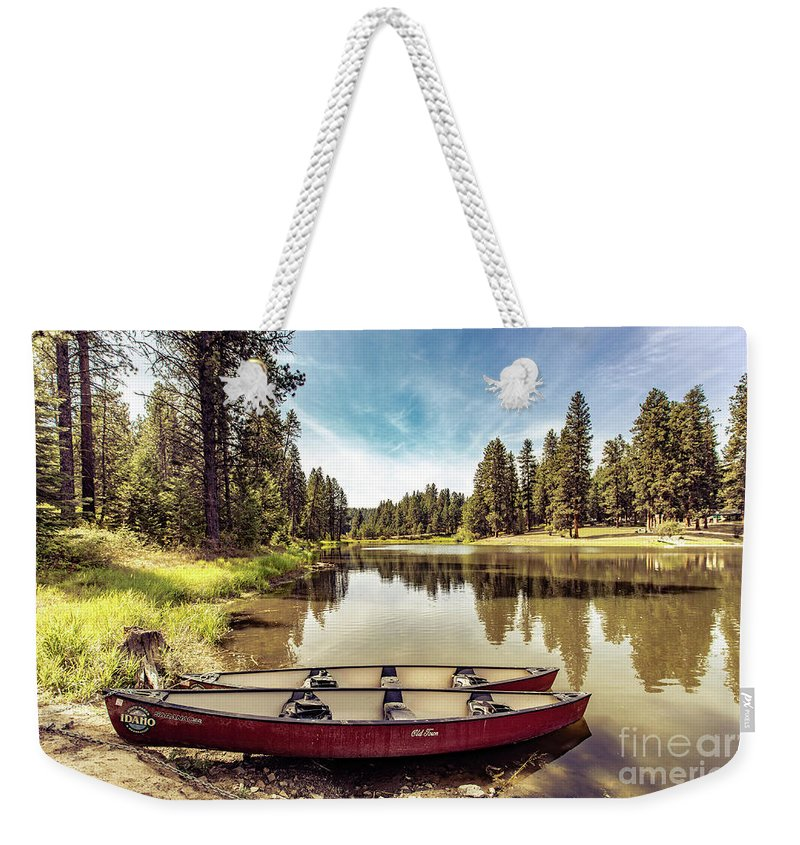 Weekender Tote Bag featuring the photograph Lone Canoes, Winchester Lake by Marcia Darby