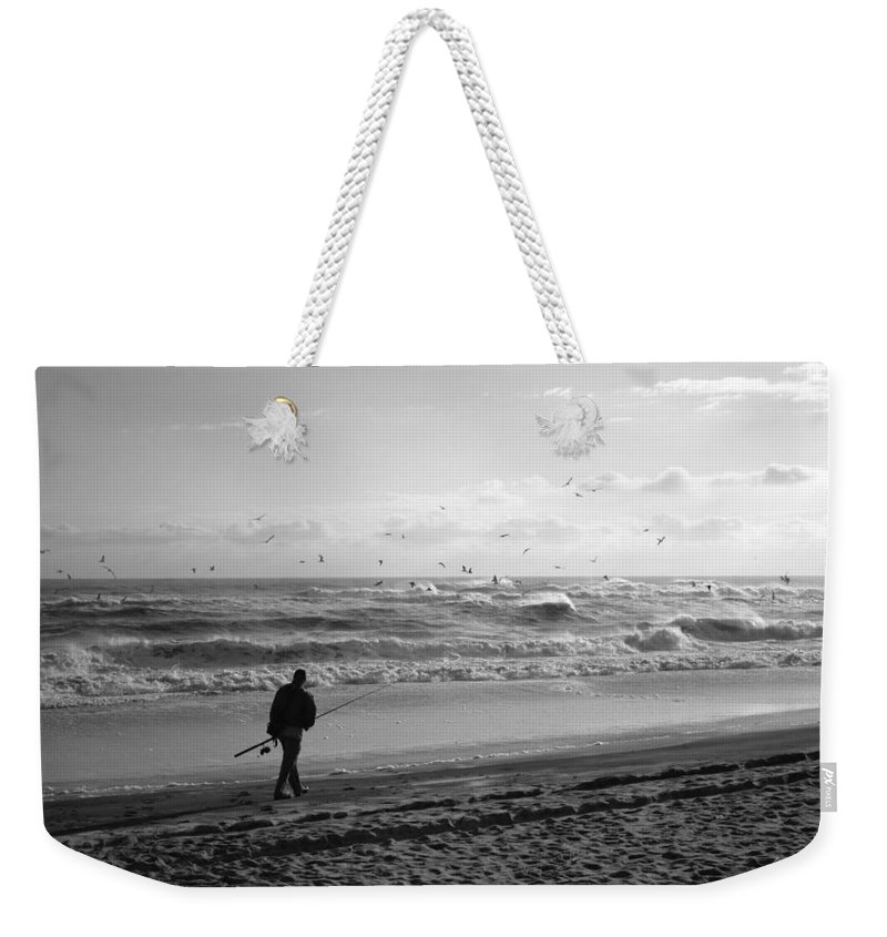 Sea Weekender Tote Bag featuring the photograph Lone Fisherman by Linda C Johnson