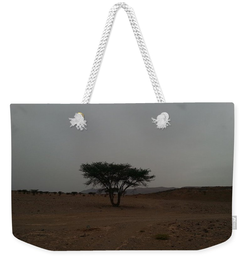Tree Weekender Tote Bag featuring the pyrography Lonely Tree In The Middle Of The Desert by Abderrazaq Oubouhmad