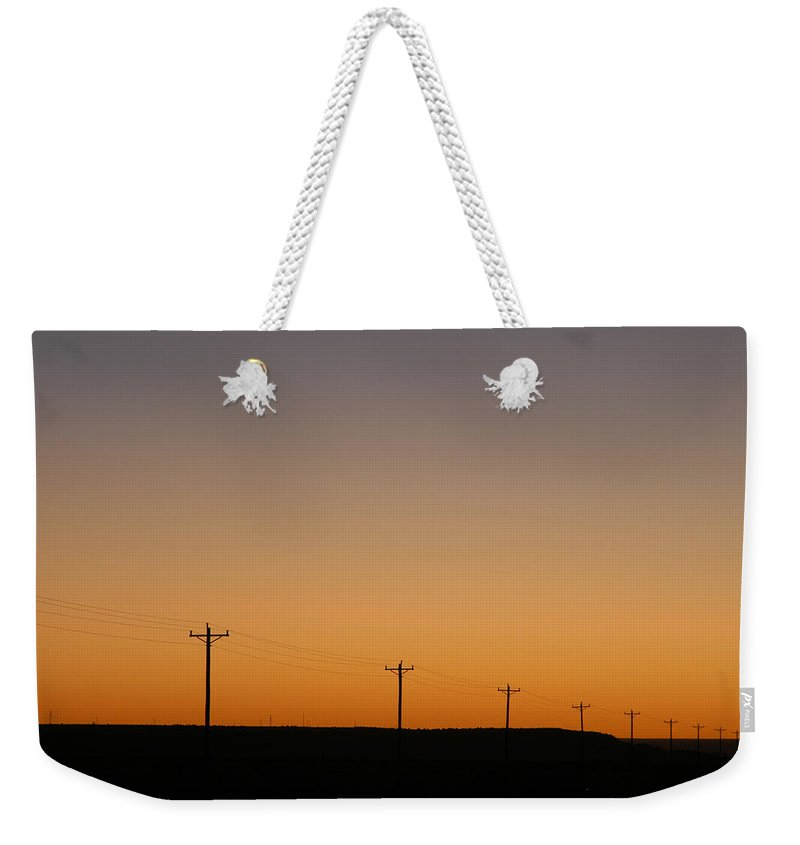 Sunset Weekender Tote Bag featuring the photograph Lonesome Road - Wyoming by D'Arcy Evans
