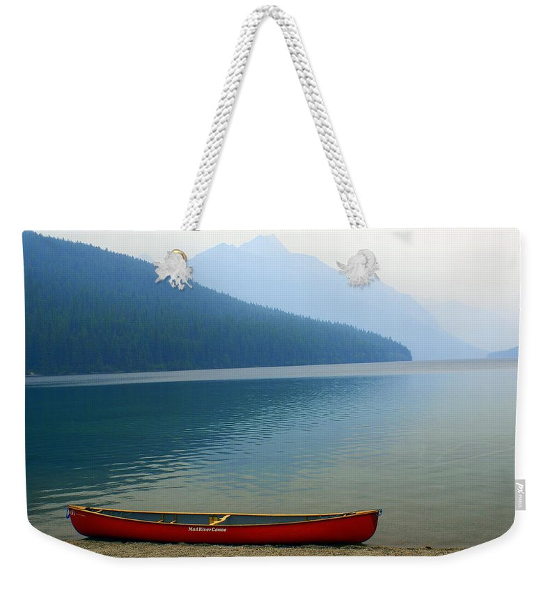 Glacier National Park Weekender Tote Bag featuring the photograph Lonly Canoe by Marty Koch