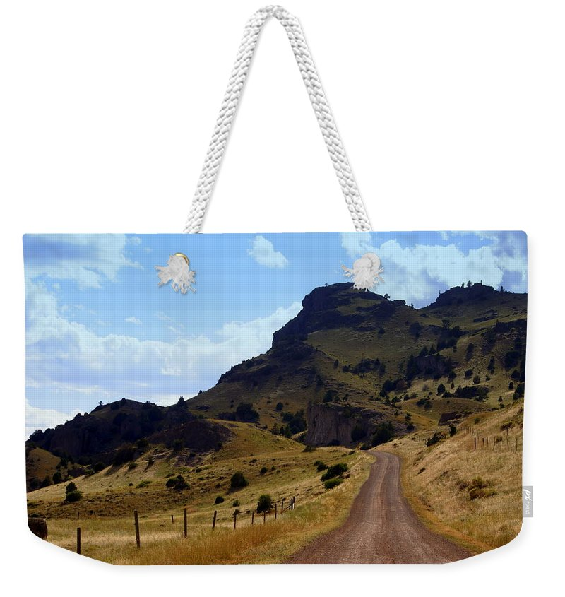 Tom Miner Rd. Weekender Tote Bag featuring the photograph Lonly Road by Marty Koch