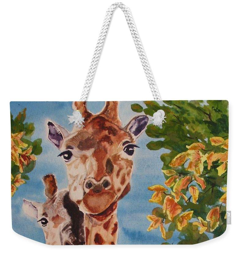 Giraffes Weekender Tote Bag featuring the painting Lookin Back by Karen Ilari