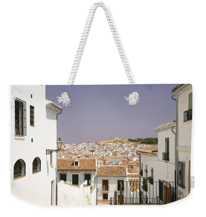 Antequera Weekender Tote Bag featuring the photograph Looking Down Over Antequera From Near The Church Of Santa Maria La Mayor by Mal Bray
