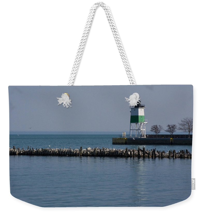 Chicago Lake Michigan Windy City Lighthouse Bird Gulls Water Blue Sky Weekender Tote Bag featuring the photograph Looking Far by Andrei Shliakhau