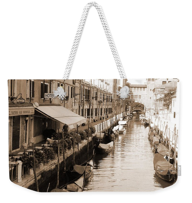 Old Times Weekender Tote Bag featuring the photograph Looks Like Old Times by Donna Corless
