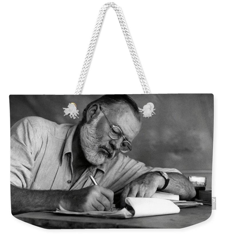 Hemingway Weekender Tote Bag featuring the photograph Love Of Writing - Ernest Hemingway by Daniel Hagerman