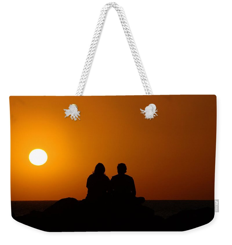 Sunset Weekender Tote Bag featuring the photograph Lovers At Sunset by Susanne Van Hulst