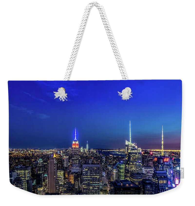 Skyline Weekender Tote Bag featuring the photograph Lower Manhattan At Night by Paul Cowell