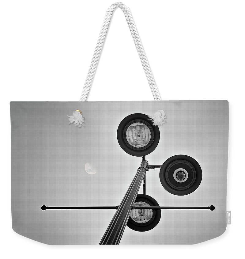 Light Weekender Tote Bag featuring the photograph Lunar Lamp In Black And White by Tom Mc Nemar