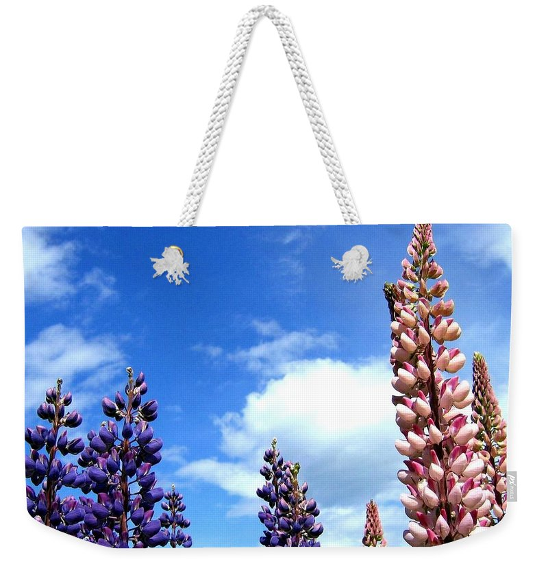 Lupins Weekender Tote Bag featuring the photograph Lupins by Will Borden