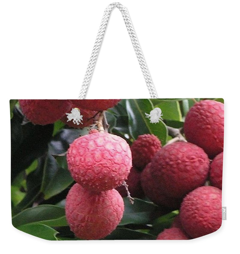 Red Weekender Tote Bag featuring the photograph Lychee by Mary Deal