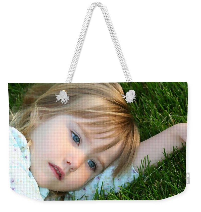 Girl Weekender Tote Bag featuring the photograph Lying In The Grass by Margie Wildblood
