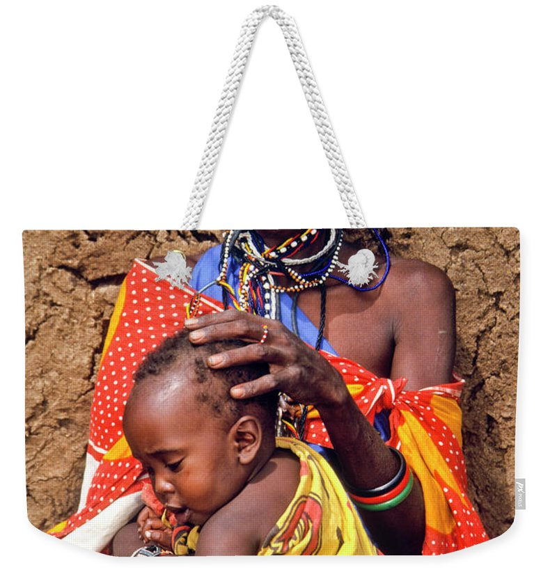 Africa Weekender Tote Bag featuring the photograph Maasai Grandmother And Child by Michele Burgess