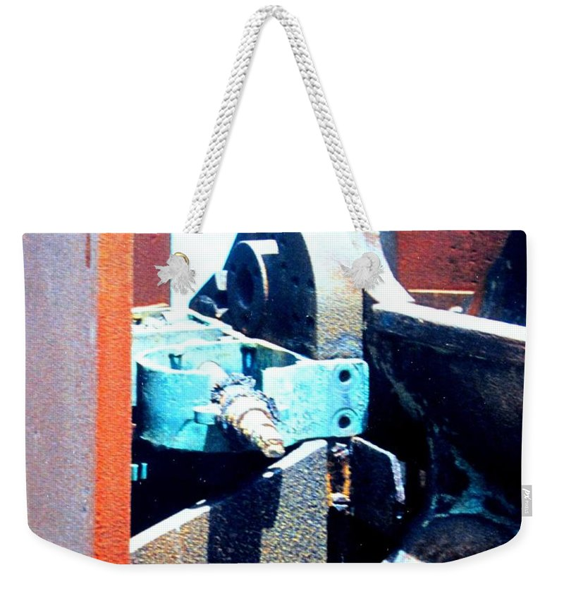 Rust Weekender Tote Bag featuring the photograph Machinery by Ian MacDonald