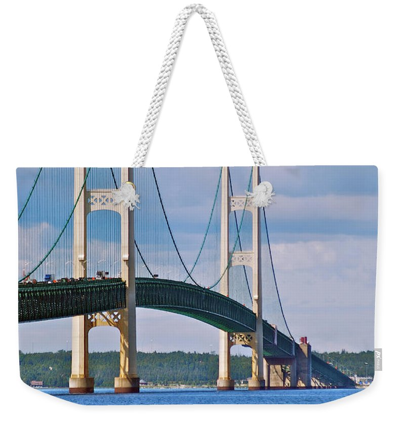America Weekender Tote Bag featuring the photograph Mackinac Bridge by Michael Peychich