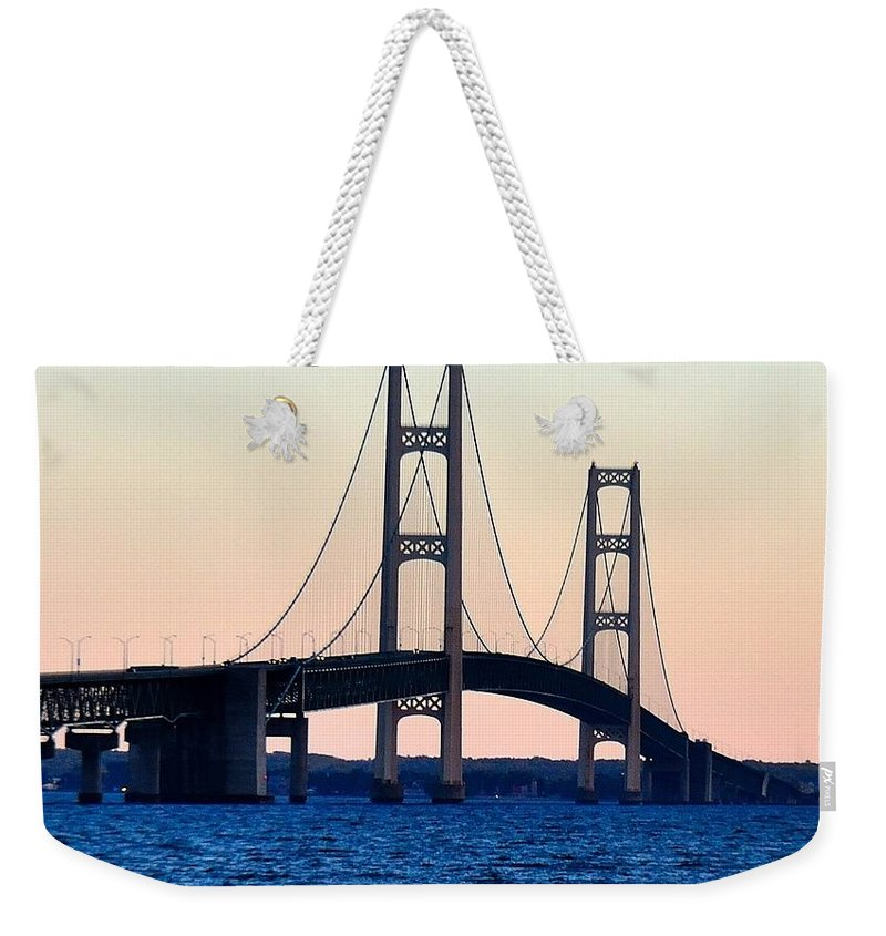 Weekender Tote Bag featuring the pyrography Mackinac Bridge Suspension Bridge In Michigan by Michael Wirmel