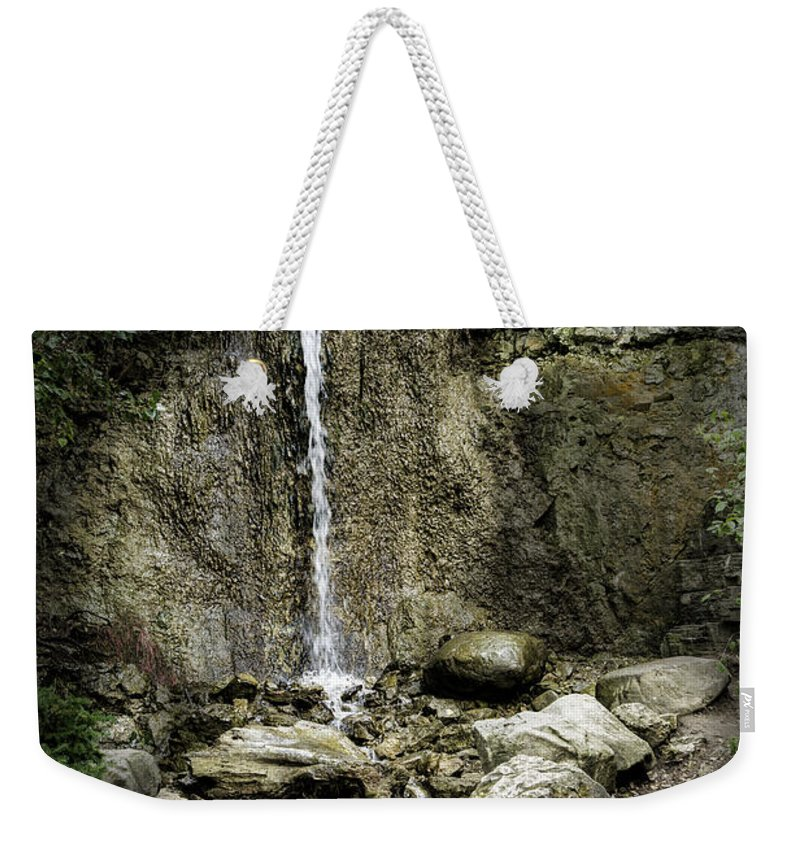 Michigan Weekender Tote Bag featuring the photograph Mackinaw City Park Waterfalls by Timothy Hacker
