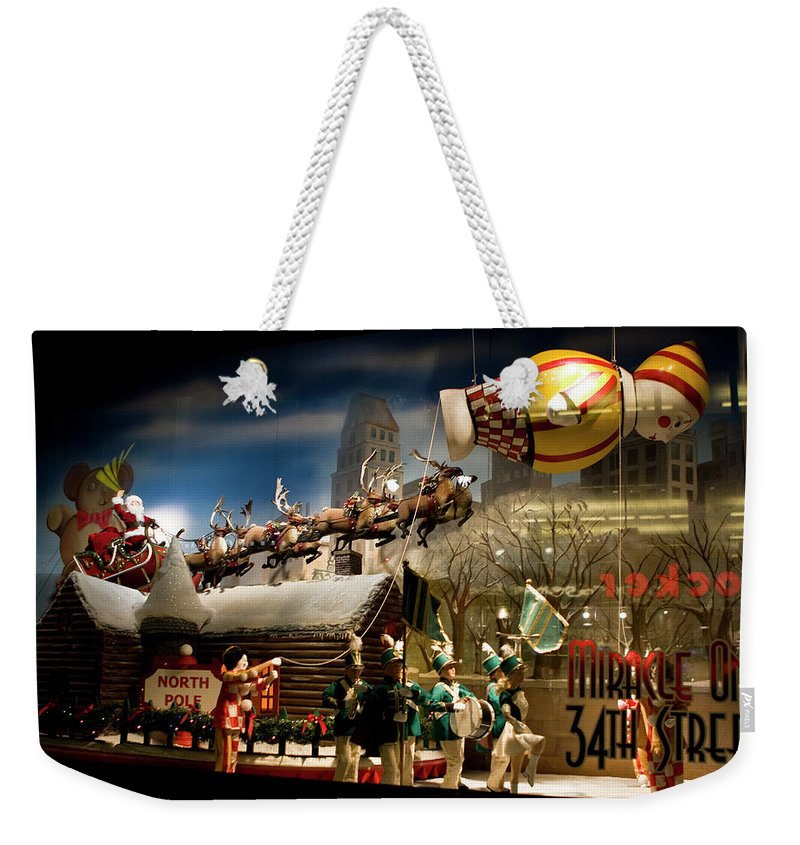 New York City Weekender Tote Bag featuring the photograph Macy's Miracle On 34th Street Christmas Window by Lorraine Devon Wilke