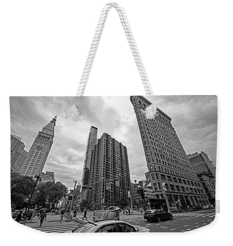 New Weekender Tote Bag featuring the photograph Madison Square Flatiron And Clock Tower New York Ny Black And White by Toby McGuire
