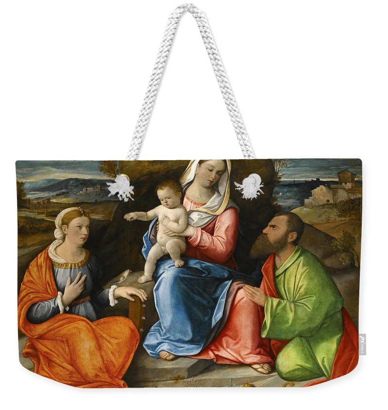 Pietro Degli Ingannati Weekender Tote Bag featuring the painting Madonna And Child With A Goldfinch With Saints Catherine And Paul Before An Extensive Landscape by Pietro degli Ingannati