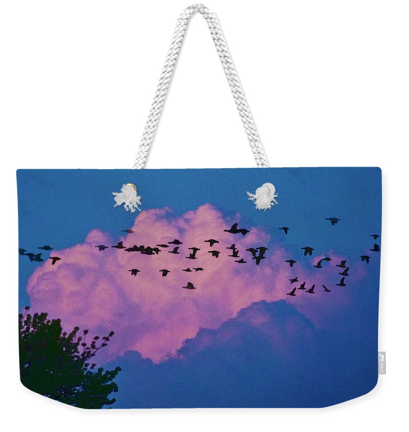 Cloud Weekender Tote Bag featuring the photograph Magenta Dream by Yuri Lev