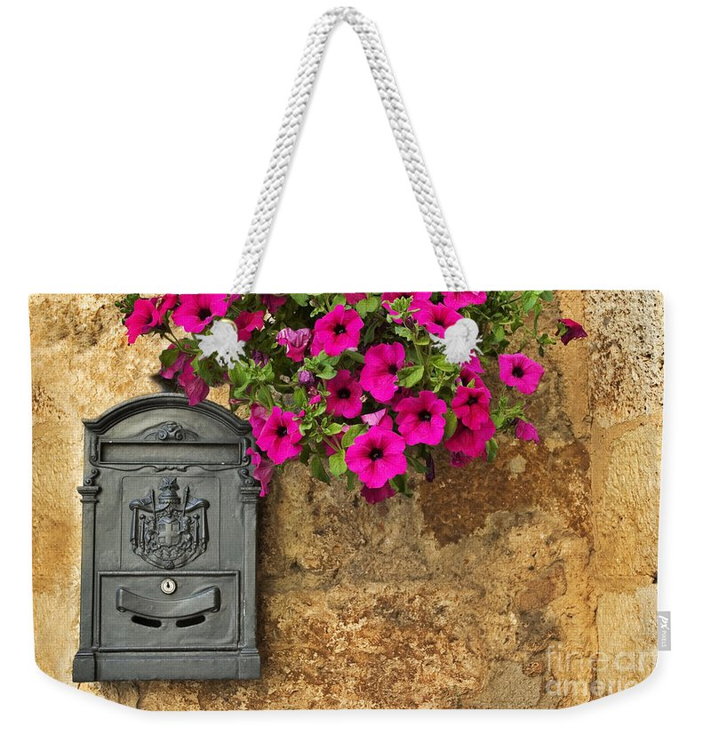 Mailbox Weekender Tote Bag featuring the photograph Mailbox With Petunias by Silvia Ganora
