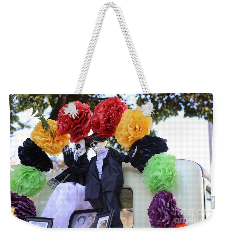 Dia De Los Muertos Weekender Tote Bag featuring the photograph Male Female Color Doll Skeleton by Chuck Kuhn