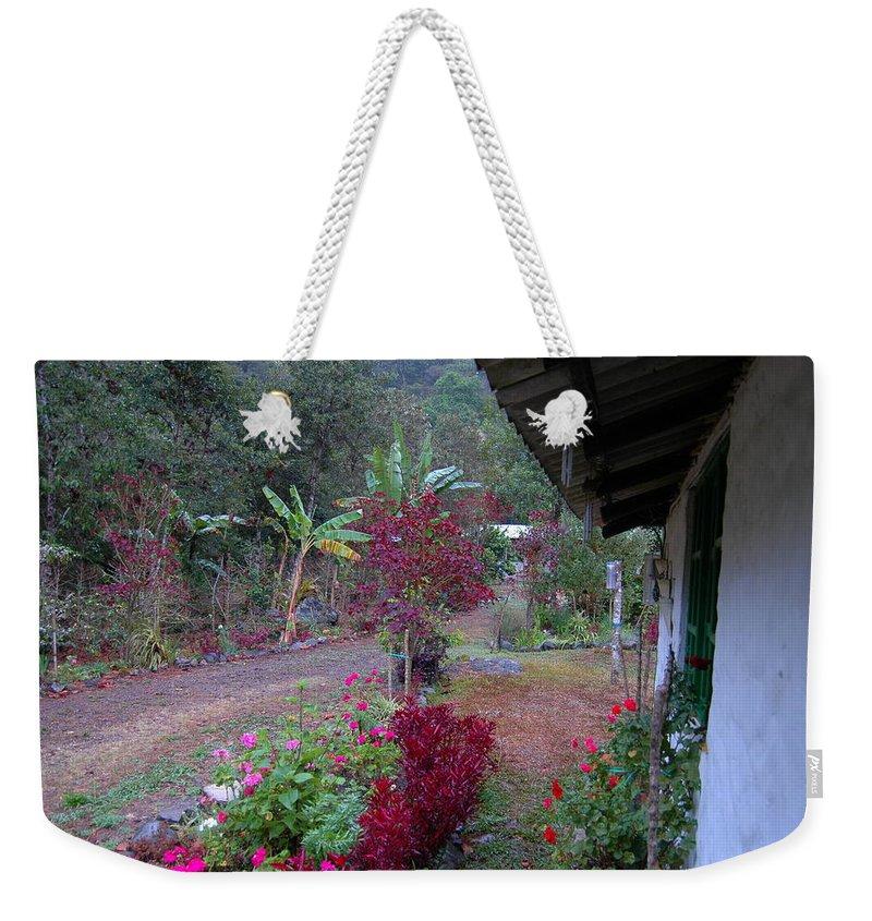 Ecuador Weekender Tote Bag featuring the photograph Mamas Yard In The Rain by Teresa Stallings