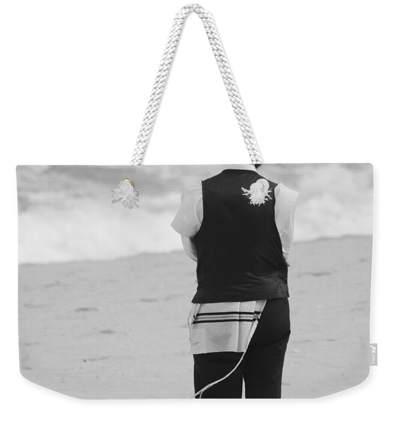 Black And White Weekender Tote Bag featuring the photograph Man And The Sea by Rob Hans