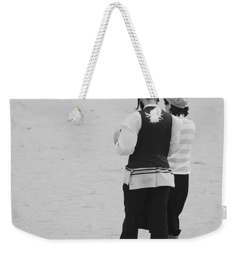 Black And White Weekender Tote Bag featuring the photograph Man And Woman by Rob Hans