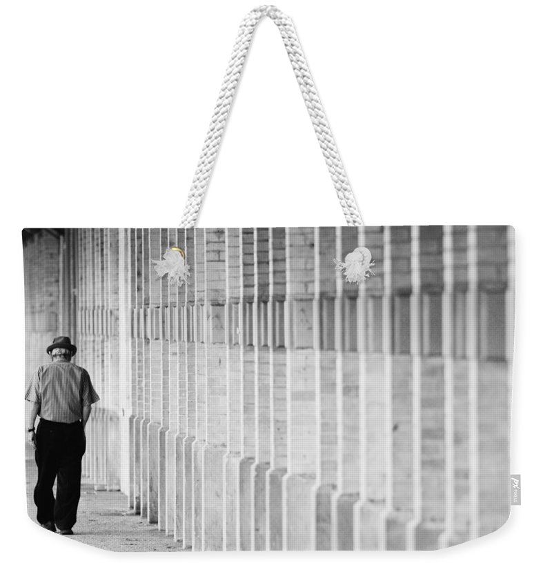 City Weekender Tote Bag featuring the photograph Man Walking by Jill Reger