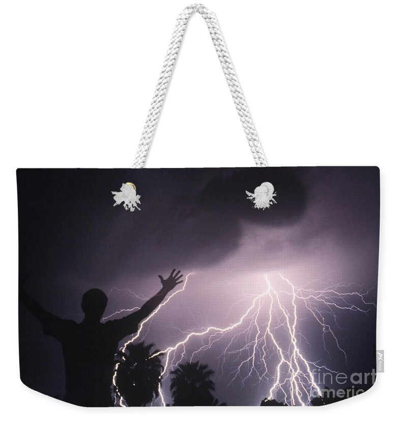 Lightning Weekender Tote Bag featuring the photograph Man With Lightning, Arizona by Kent Wood