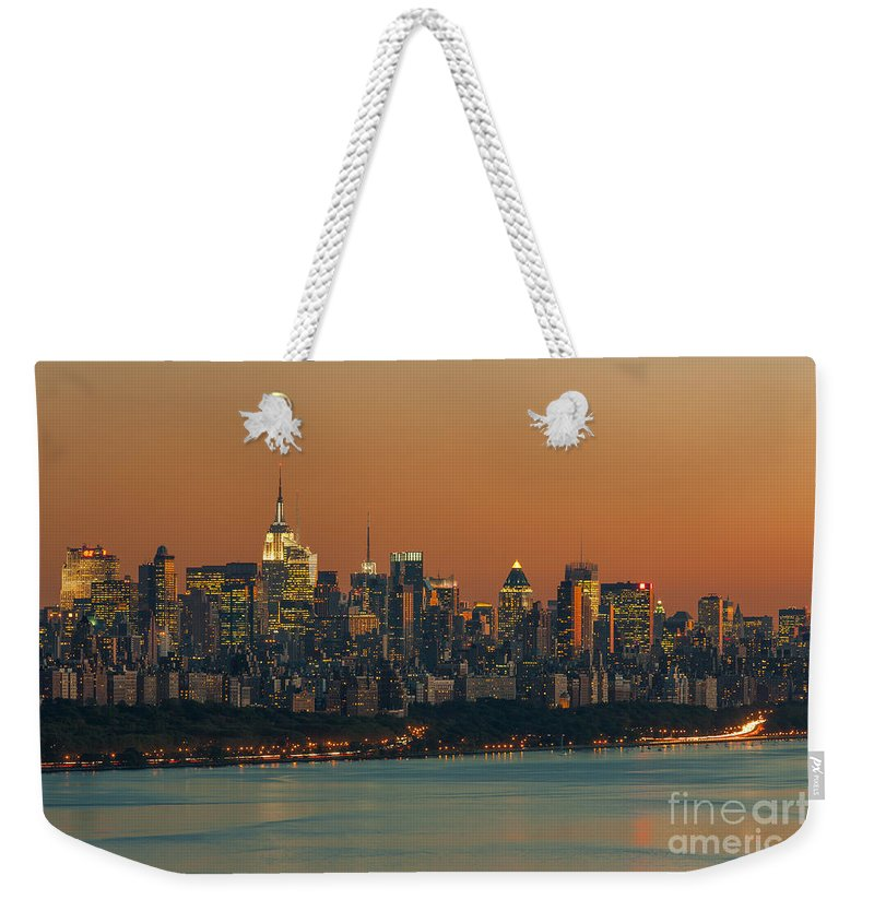 Clarence Holmes Weekender Tote Bag featuring the photograph Manhattan Twilight I by Clarence Holmes