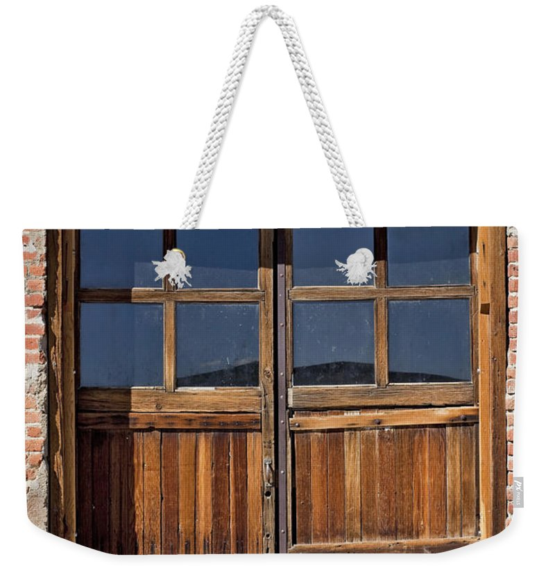 Old Wood Door Weekender Tote Bag featuring the photograph Many Textures by Kelley King