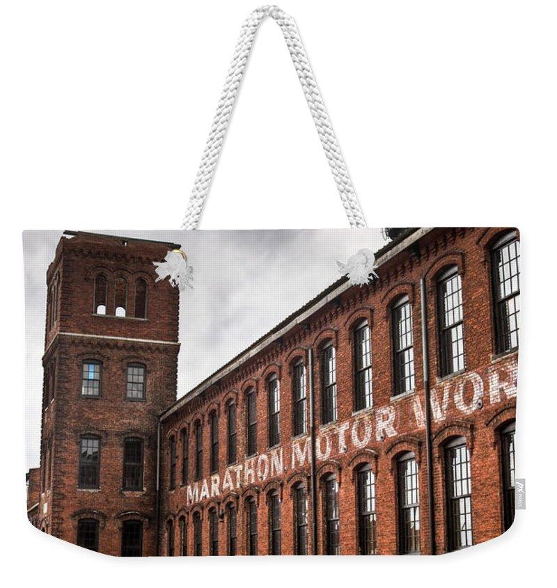 Marathon Weekender Tote Bag featuring the photograph Marathon Motor Cars Building by Douglas Barnett