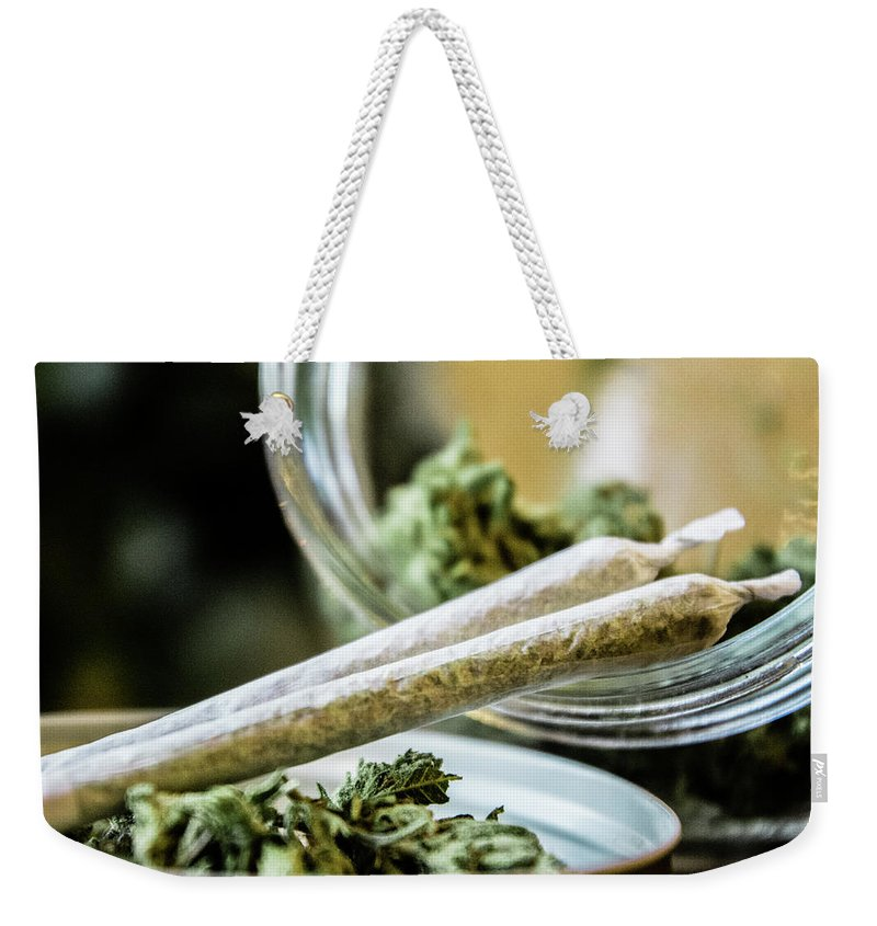 Cannabis Weekender Tote Bag featuring the photograph Marijuana Joint by Mitch McMaster
