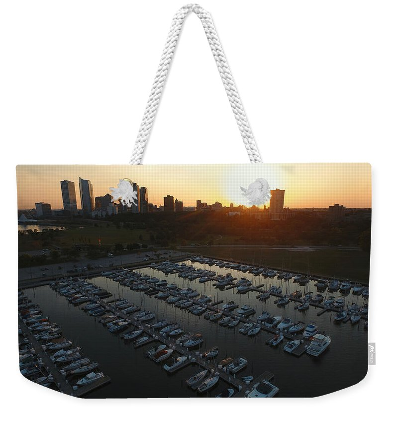 Marina Weekender Tote Bag featuring the photograph Marina Sunset by Steve Bell