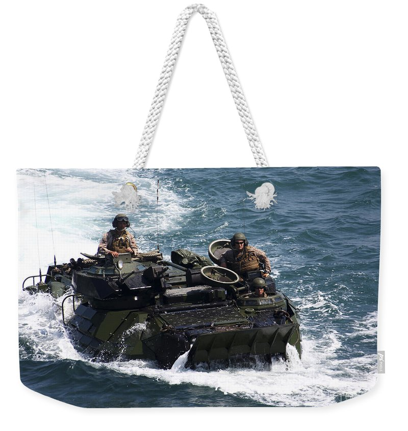 Us Marine Corps Weekender Tote Bag featuring the photograph Marines Operate An Amphibious Assault by Stocktrek Images